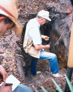 William Blake Parker takes soil sample